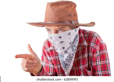 boy dressed up as a bandit for halloween holds his hand like a gun isolated on white
