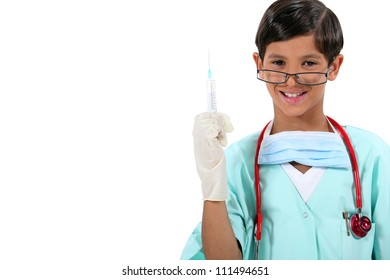 Boy dressed as doctor holding needle