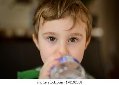 Boy drinking bottled water