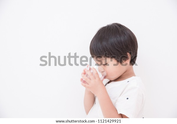 A boy drinking water with a cup
