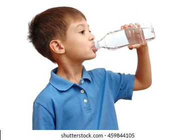 Boy drinks water from bottle isolated on white background