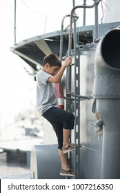 Boy  driving war ship military at the national museam