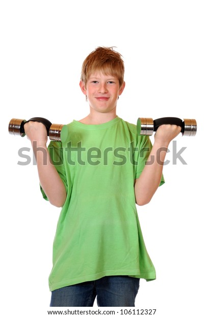 Boy with dumbbells in front of a white background