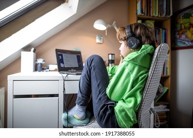 Boy during distance learning during lockdown in London, UK