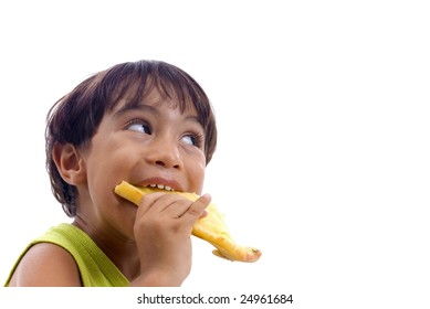 Boy eating and concentrated seeing some thing.