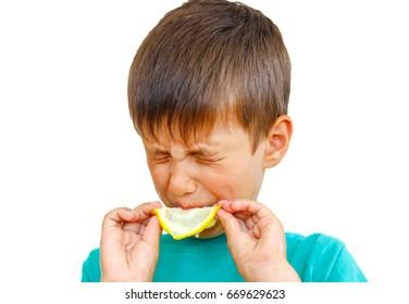 Boy eating fresh lemon isolated on white background. Citrus.portrait boy with lemon.