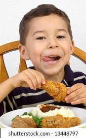 Boy eating a fried chicken dinner