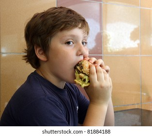 The boy eating hamburger