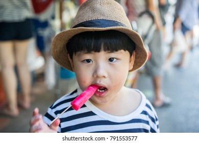 A boy is eating a ice cream.