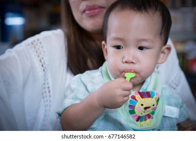 A boy is eating ice-cream