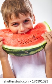 Boy is eating a watermelon isolated on a white background