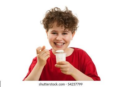 Boy eating yogurt isolated on white background