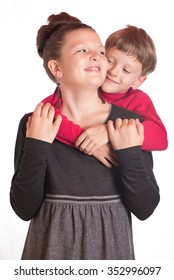 The boy embraced the girl behind for a neck.