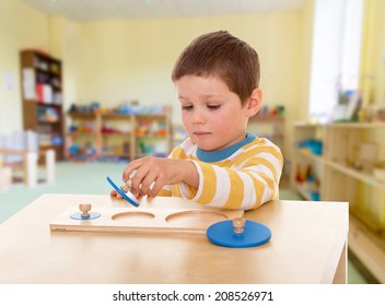 Boy engaged in the Montessori classroom.kindergarten, the concept of childhood and joy, teens