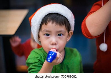 A boy is enjoying the christmas party.
