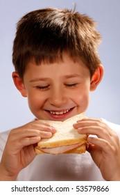 boy enjoying eating sandwich
