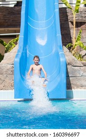 Boy enjoying ride on water slide