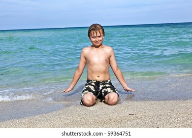 boy enjoys the crystal clear water in the ocean