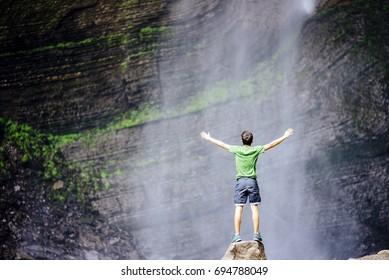 Boy enjoys the Gocta waterfall in nothern peru Gocta Waterfall/ Chachapoyas/ Peru/ south america