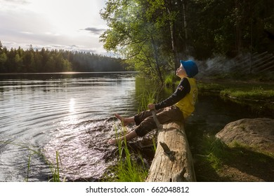 The boy enjoys the summer on the lake, Finland