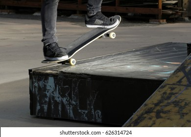Boy in equilibrium on the skateboard