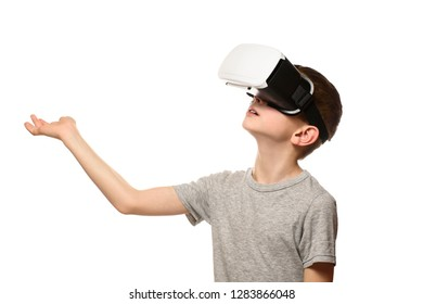 Boy experiencing virtual reality arm outstretched in front of him. Isolate on white background. Technology concept.