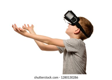 Boy experiencing virtual reality arms outstretched in front of him. Isolate on white background. Technology concept.