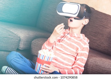 Boy experiencing virtual reality at home