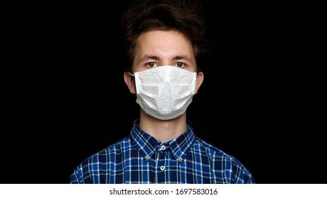 Boy feeling sick and wearing mask.