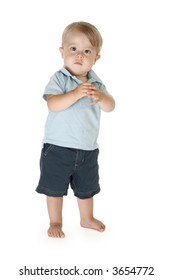 Boy of fifteen months standing barefoot over white background.