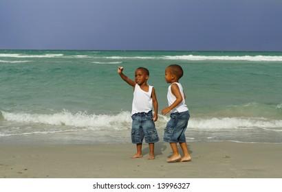 Boy Finding a Sea Shell
