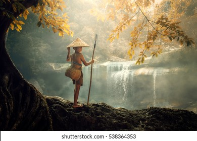 Boy Fisherman fishing at river