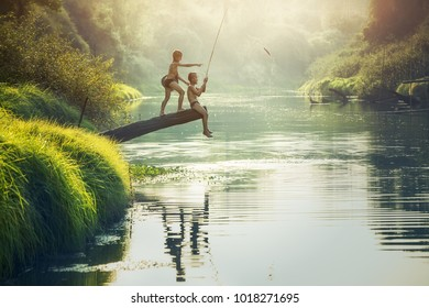 Boy fishing at the river, Countryside of Thailand
