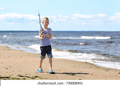 Boy with a fishing rod on the shoulder goes fishing in sea