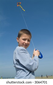 boy flying his colorful kite (blue sky)