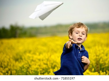 Boy Flying a Paper Airplane