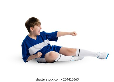 Boy football player in blue uniform against white background