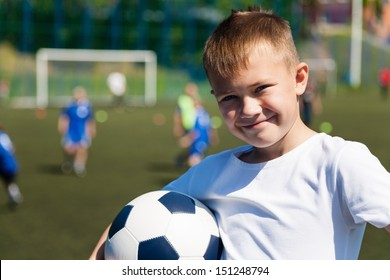 Boy football player at a football game.