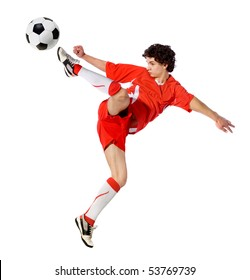 boy a footballer beating on a ball in a jump on a white background