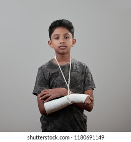 Boy with a fractured hand in plaster cast