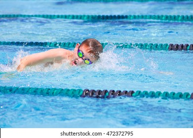 Boy in a freestyle swim race