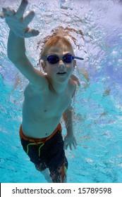 Boy freestyle swimming, underwater shot