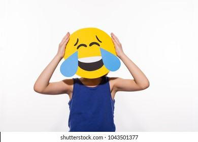 Boy with funny loud laughing emoji head, face with tears of joy, LOL