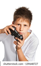 Boy with games controller. Studio shot on white background.
