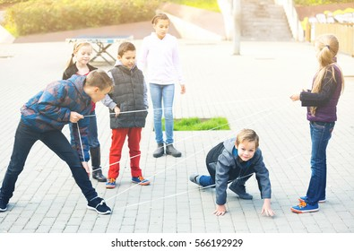 Boy gently passes through the tangled rope