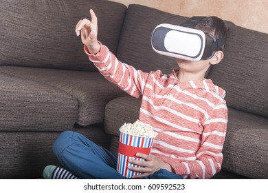 Boy gesturing while using virtual reality headset at home