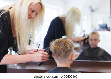 a boy gets a new hair cut at the hairdresser