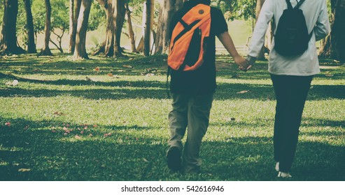 Boy and girl Back to school with school bags behind the back, vintage color tone and blurred focus for education concept background