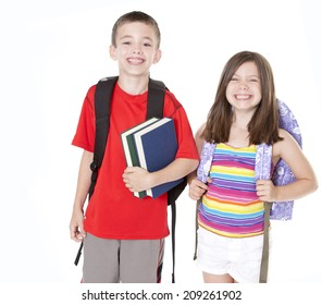 Boy and girl with backpacks and books isolated on white.