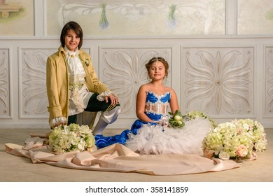 Boy and girl  in a beautiful dress with flowers